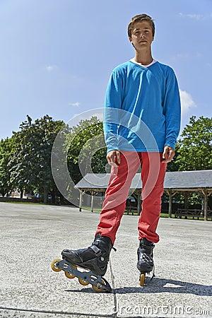 Teenager rollerblading