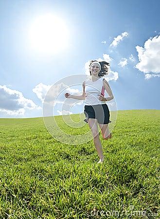 Teenager running through field