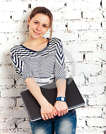 Teenager schoolgirl with laptop