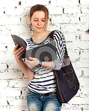 Teenager schoolgirl with textbook