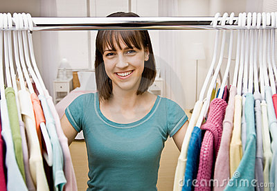 Teenager searching in closet for something to wear