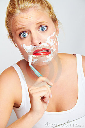 Teenager shaving face