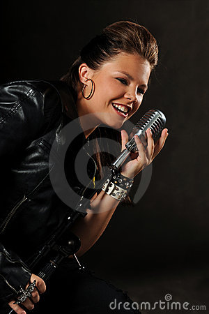 Teenager Singing inot vintage Microphone