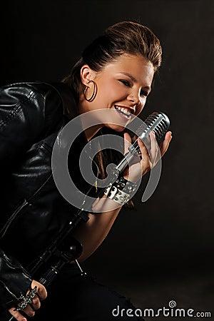 Teenager Singing inot vintage Microphone