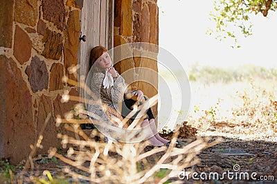 Teenager sitting in doorway
