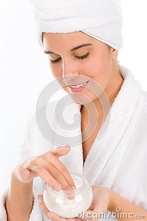 Teenager skin care - woman apply moisturizer