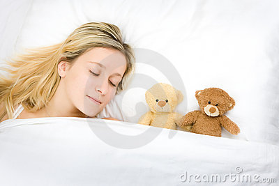Teenager sleeping with teddies