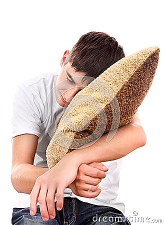 Teenager sleeps with Cushion