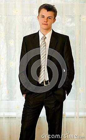 Teenager in smart black suit
