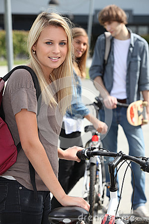 Teenager stood by bicycle