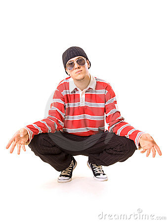 Teenager in sunglasses sitting on the floor