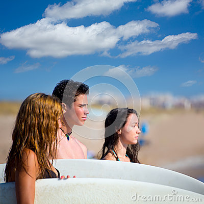 Teenager surfers group happy in beach shore