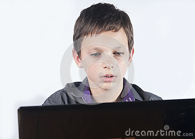 Teenager surfing the net ,over white background.