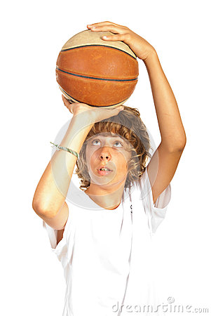 Teenager throwing basketball