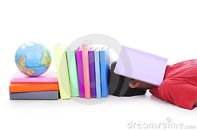 Teenager tired sleeping with books