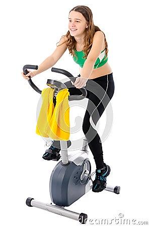 Teenager on training bicycle