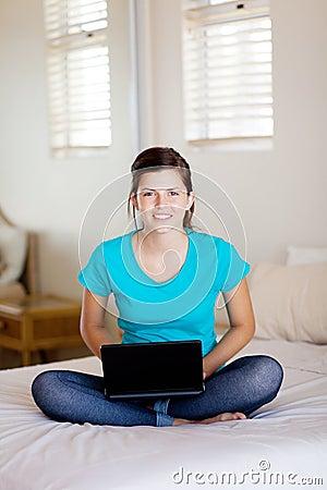 Teenager using laptop