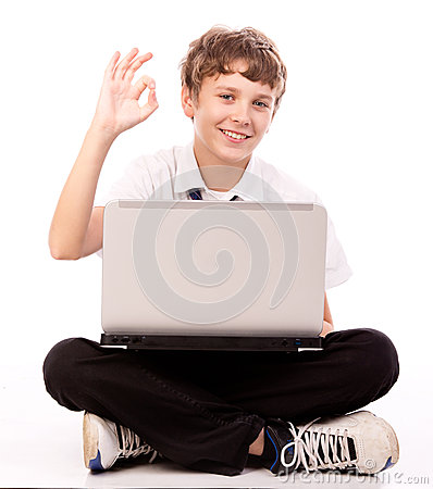 Teenager using laptop - ok gesture