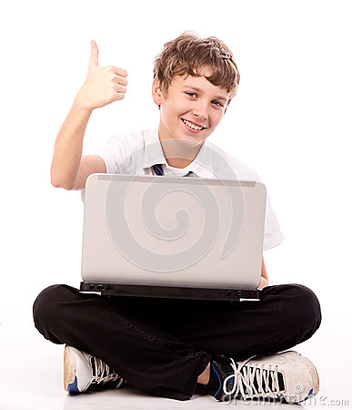 Teenager using laptop - thumb up