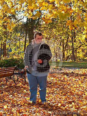 Teenager walking in park in fall