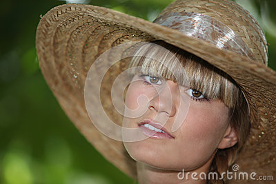 Teenager wearing straw hat