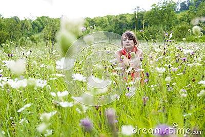 Teenager in wildflower field