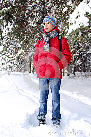 Teenager in winter forest