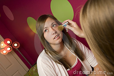 Teenagers applying makeup