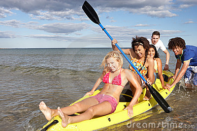 Teenagers in canoe in the sea