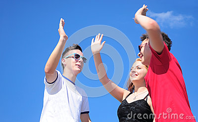 Teenagers giving five