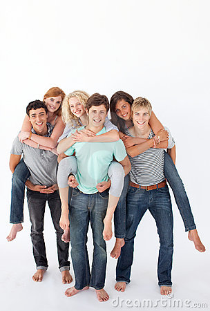 Teenagers giving their friends piggyback rides
