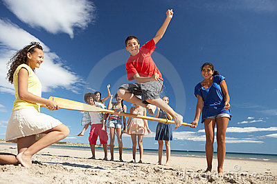 Teenagers having fun on beach