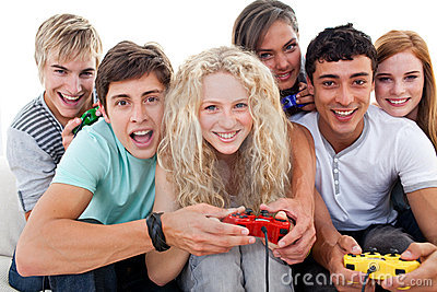 Teenagers having fun playing video games