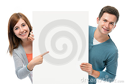 Teenagers holding at a blank board