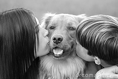 Teenagers Kissing Dog