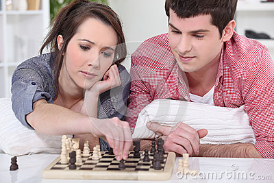 Teenagers playing chess.