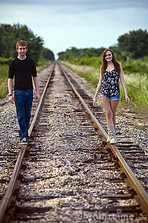 Teenagers on railway tracks