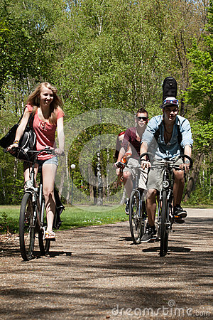 Teenagers riding on bicycles