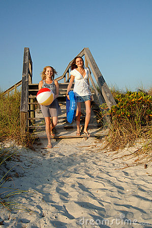 Teenagers running to the beach