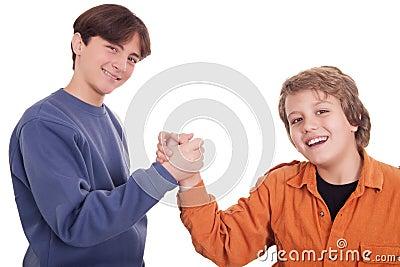 Teenagers shaking hands