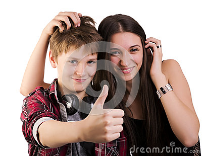 Teenagers shows thumbs up