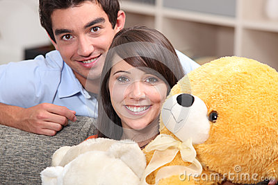 Teenagers with a teddy bear