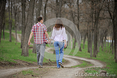 Teenagers Walking Along Alley