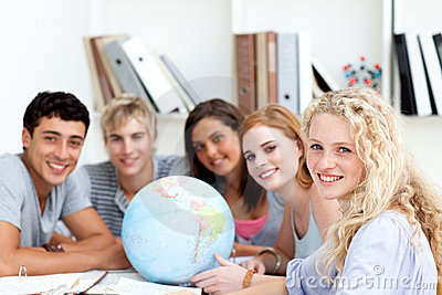 Teenagers working with a terrestrial globe