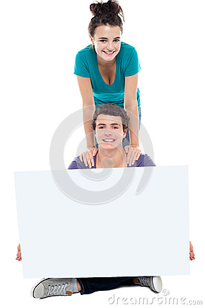 Teens advertising white blank billboard