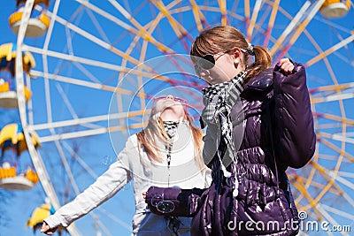 Teens against a ferris wheel