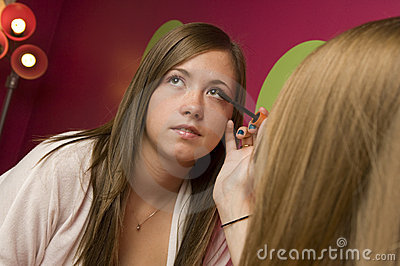 Teens applying makeup