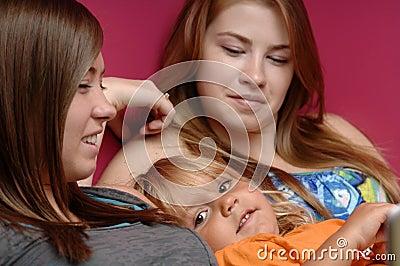 Teens baby-sit little girl