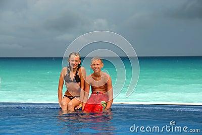 Teens in beachside pool