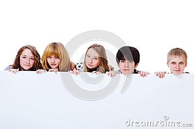 Teens behind poster